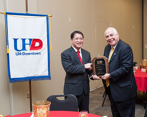 UHD President Bill Flores (right) presents Daniel Liao, ambassador and director general of the Taipei Economic and Cultural Office (TECO) in Houston, with a commemorative plaque following his presentation to faculty and students today.
