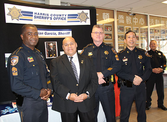 HCSO Sgt. Felipe Rivera (second from left), head of the recent Cypress murders case, stands with colleagues at the town hall meeting.