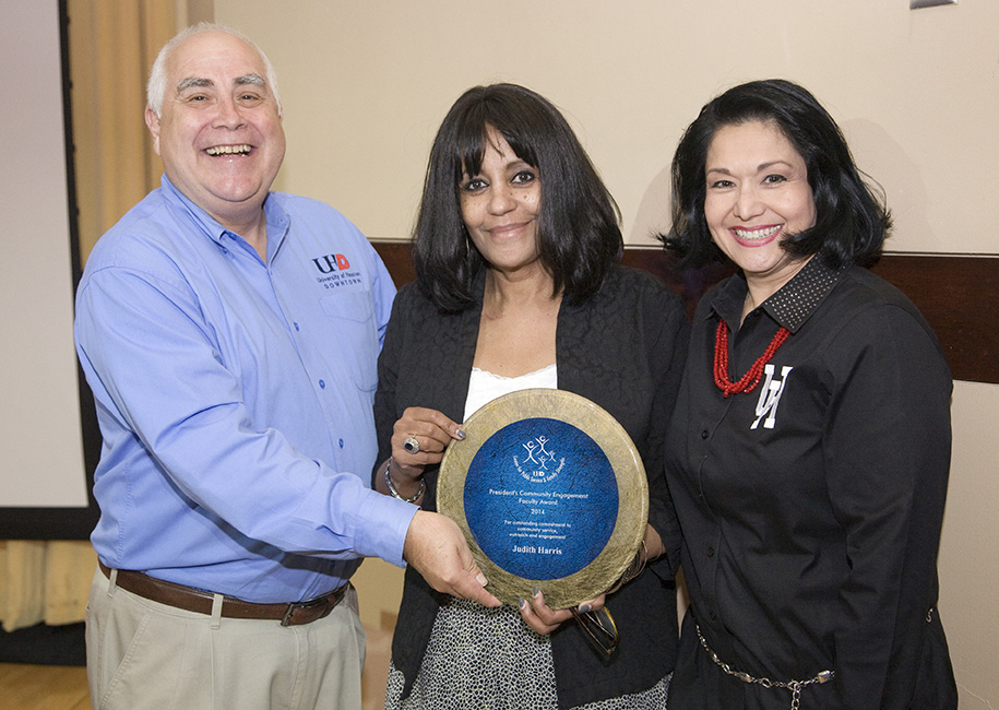 Judith Harris received the President's Community Engagement Award from President Flores and Regent Mendoza.