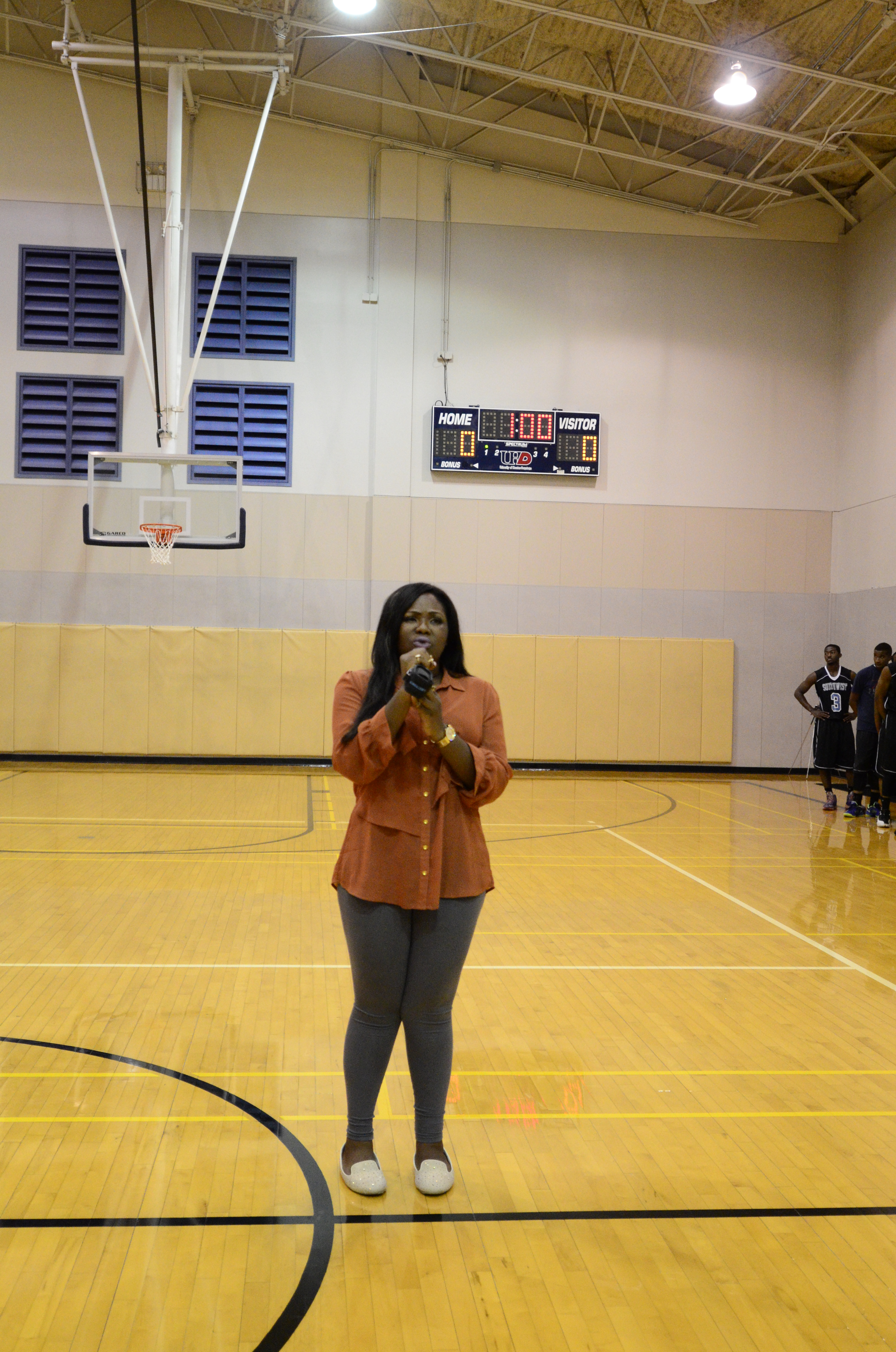 UHD student Benita Amadi belts out the national anthem Friday night