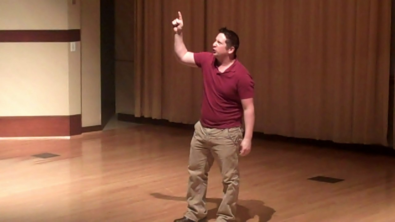 Chuck Hutchison recites a monologue as Julius Caesar.