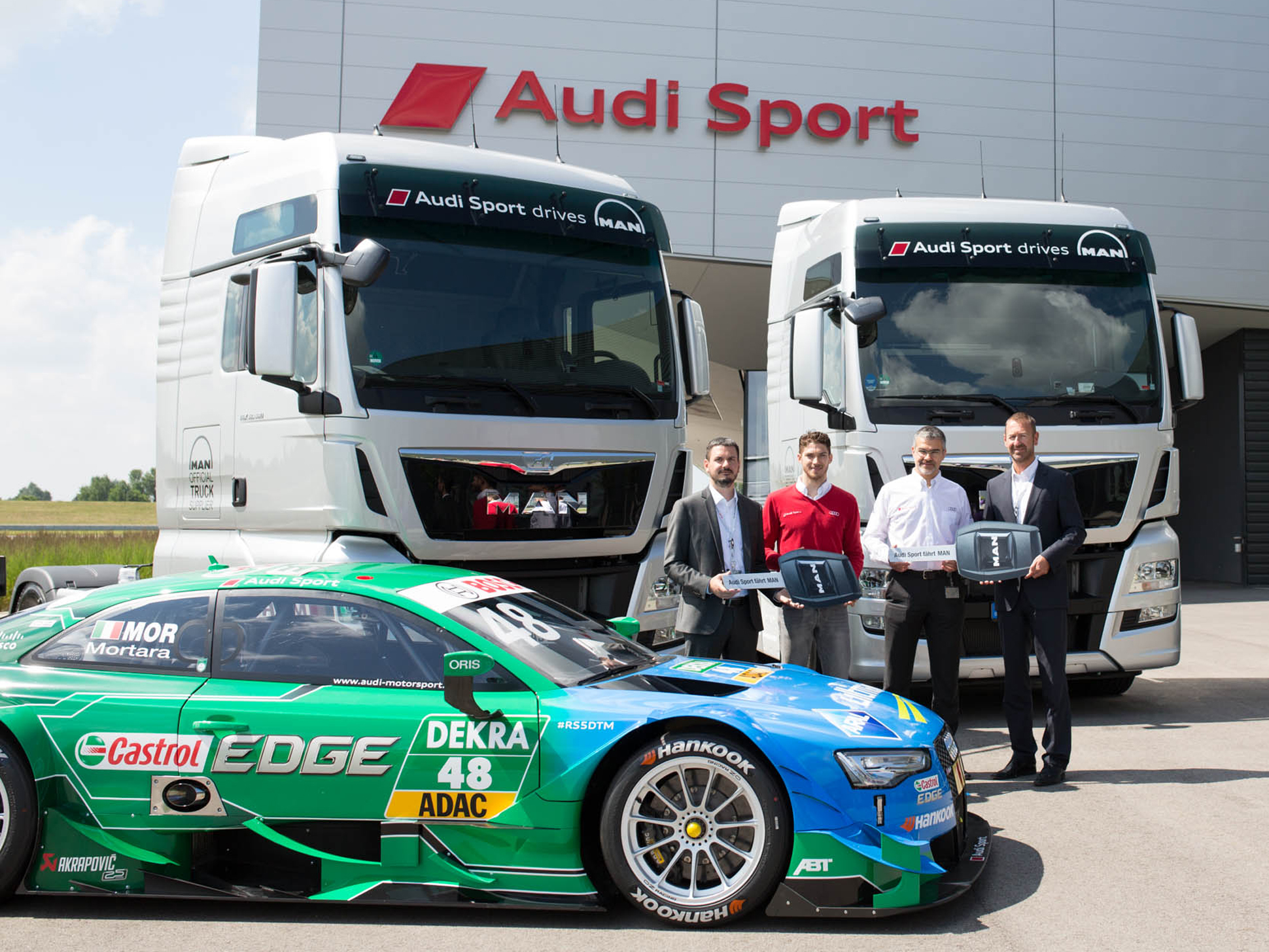 Symbolic key handover in front of MAN TGX-trucks and DTM Audi RS5