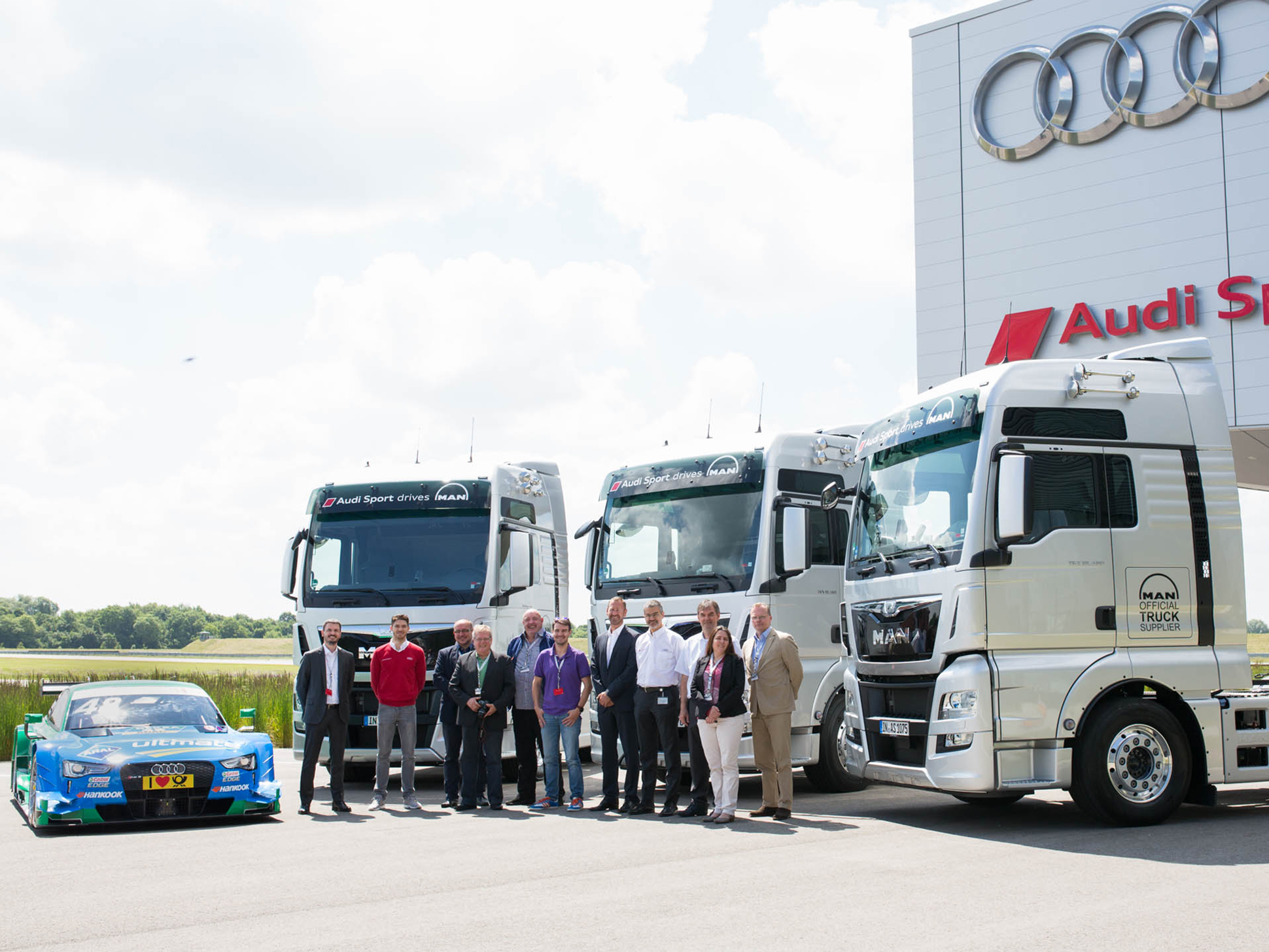 Audi Sport receives eight new MAN TGX tractor units. Representatives of Audi Sport und MAN at the handover.