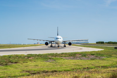 An aircraft uses the end-around taxiway that DFW Airport opened in 2008.  DFW Airport today received a funding commitment from the Department of Transportation for $180 million to build two more end-around taxiways.