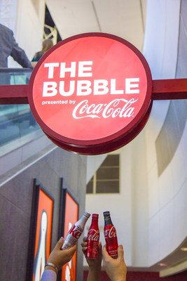 "Dallas Fort Worth International Airport and Coca-Cola® Toast Opening of ""The Bubble Presented by Coca-Cola""."