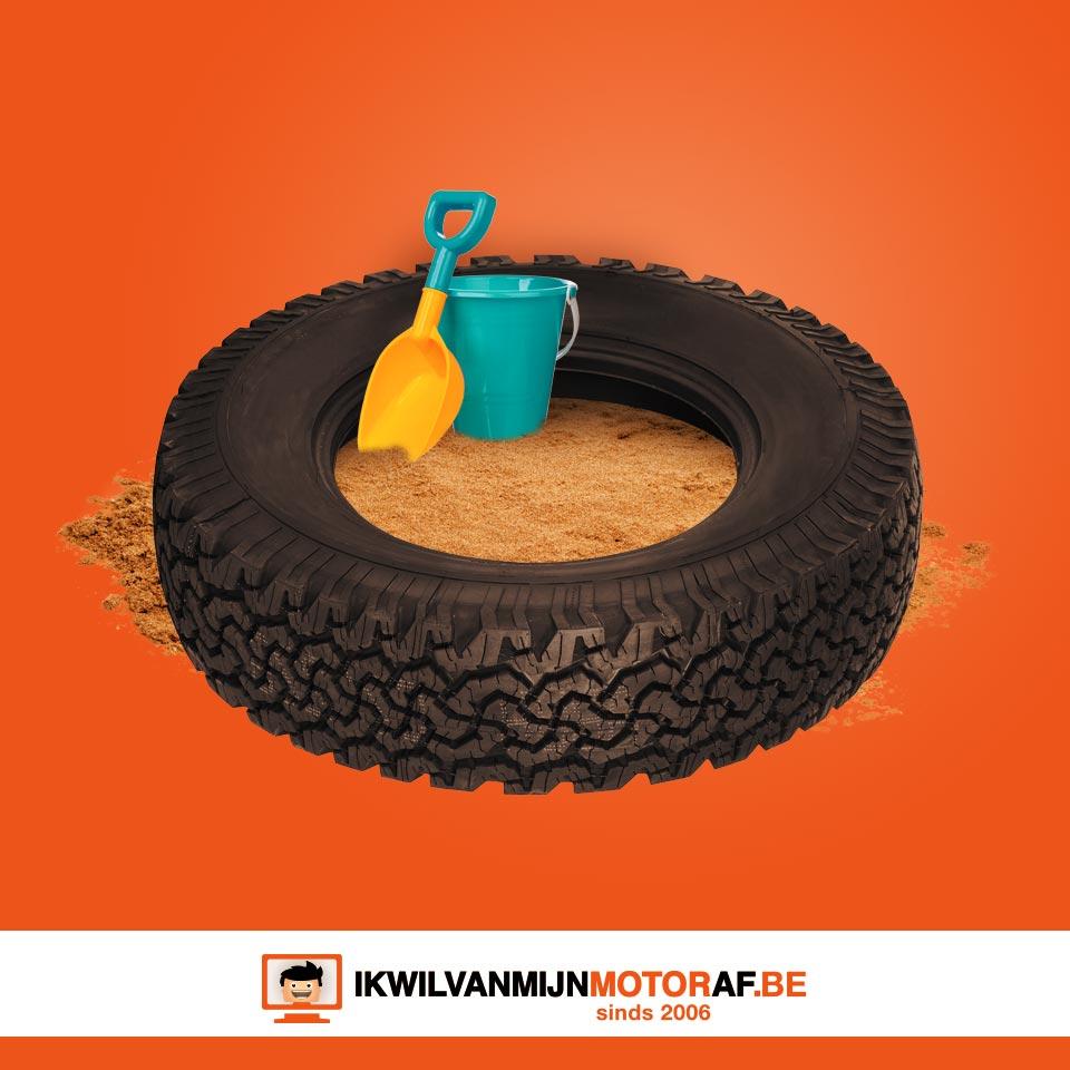 Zandbak van motorband