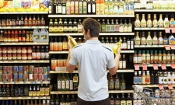 Which supermarket was cheapest in July 2015?
