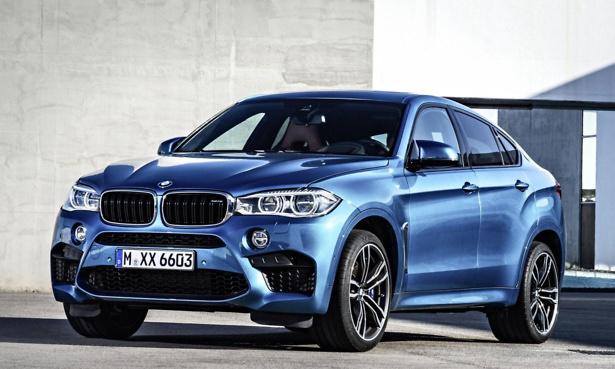 BMW X6 - metallic blue, parked at a jaunty angle