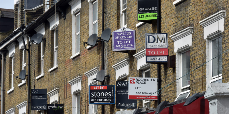 London, UK -April 10th 2016: Commercial real estate rental signs attached to the wall of apartments To Let in the Camden, Mansfield Road NW3