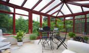 Conservatory with plants and small table and chairs