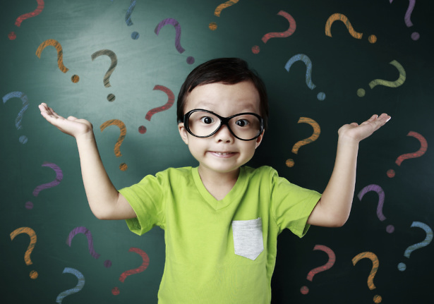 Child holding hands up, surrounded by question marks