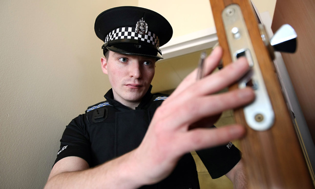 Policeman visiting a house after a burglary