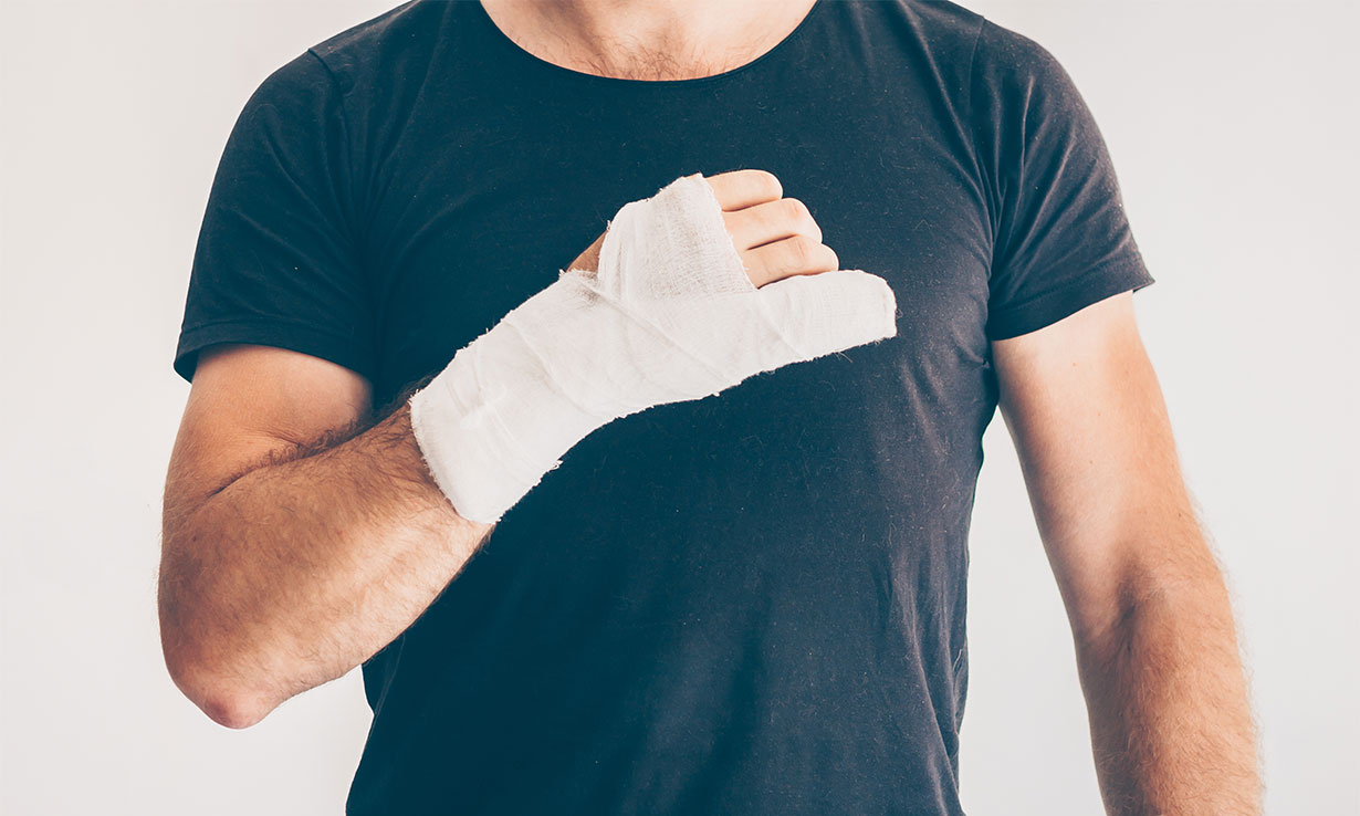 Man with hand and wrist in bandage after disastrous DIY job