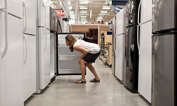 Woman shopping for a new fridge