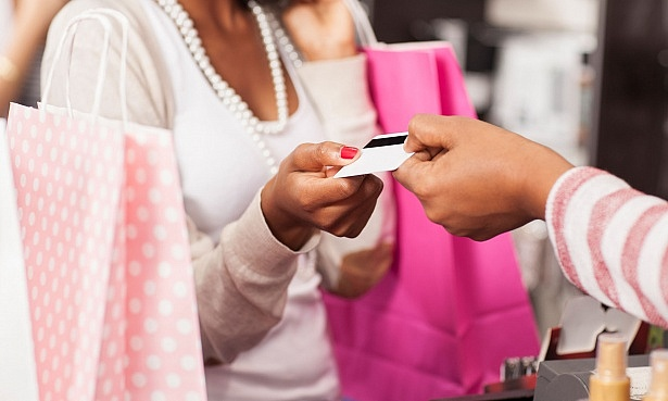 Woman paying at till