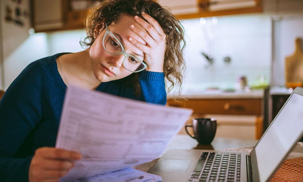 Woman looking at energy bills