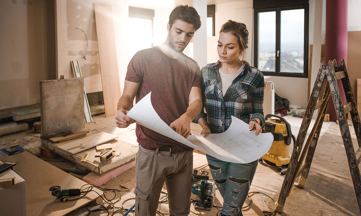 Homeowners looking at construction plans