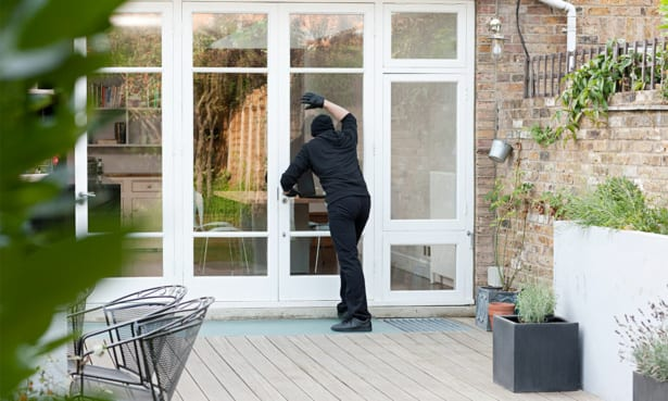 Robber looking into a house