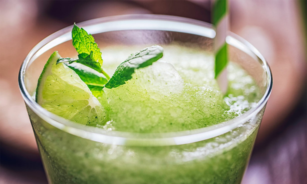 Icy green frozen cocktail with mint and lime