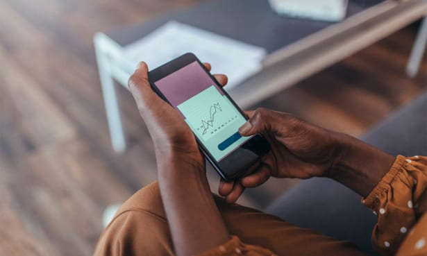 person looking at sleep tracking graph on smartphone