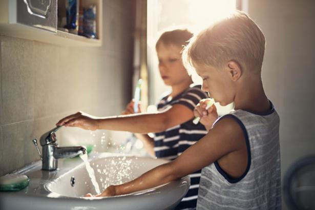 Little brothers brushing teeth