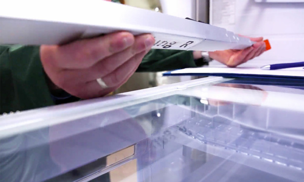 Which? expert measuring space inside a fridge freezer