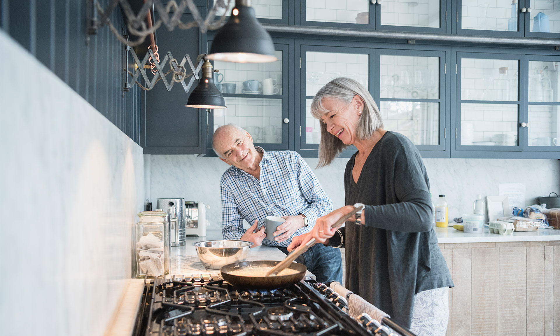 Couple cooking on a gas hob