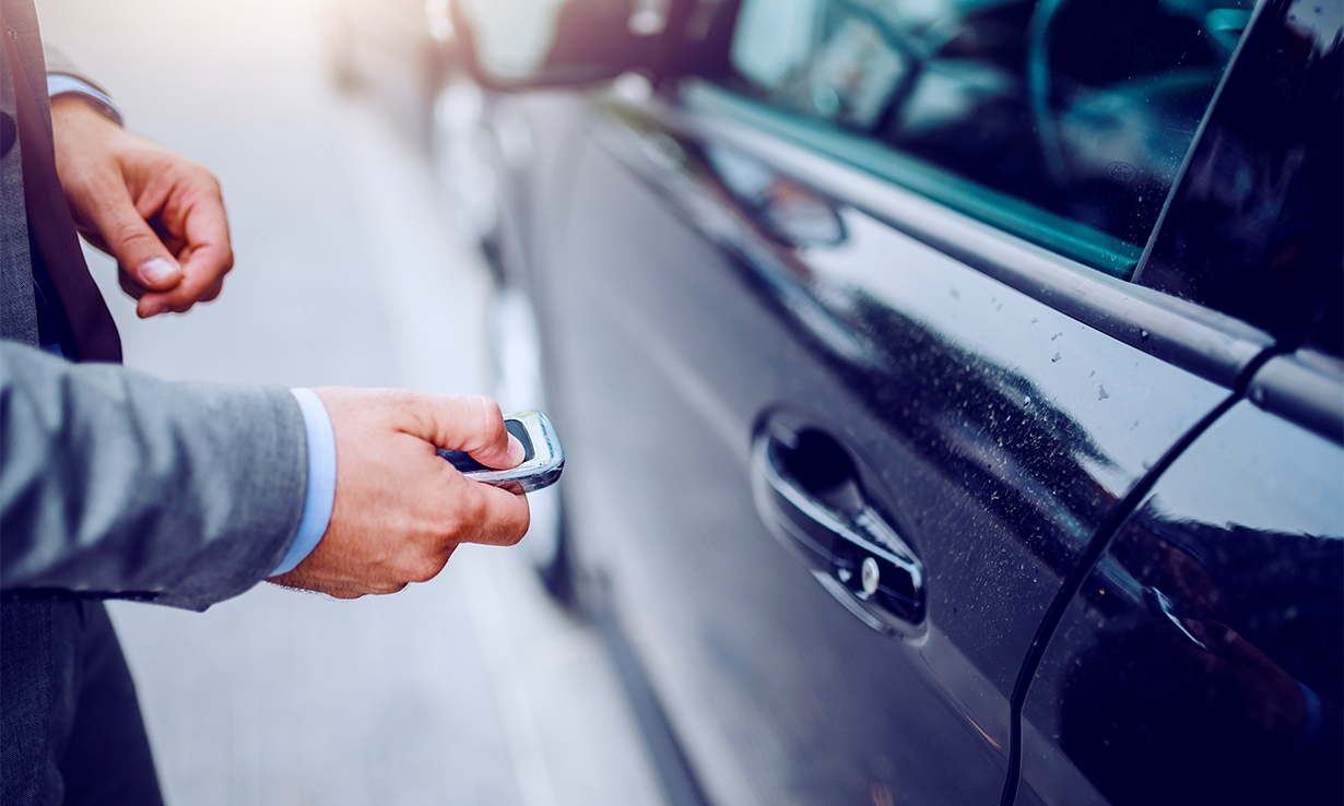 Driver using a key fob to open a car