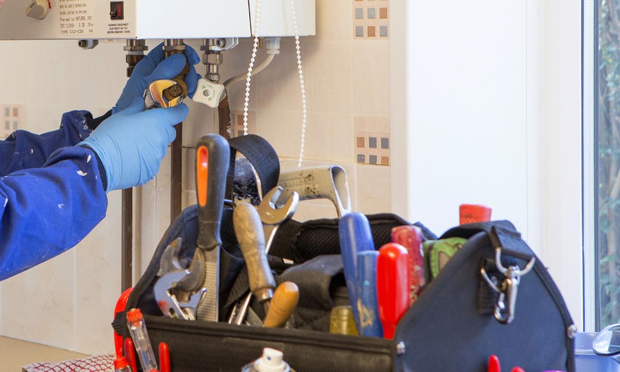 Boiler engineer wearing disposable gloves