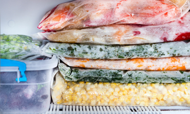 vegetables in plastic freezer bags stored flat on top of each other in the freezer