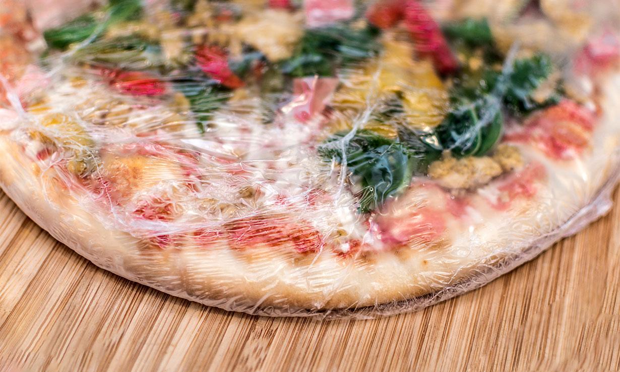 Pizza in plastic wrap