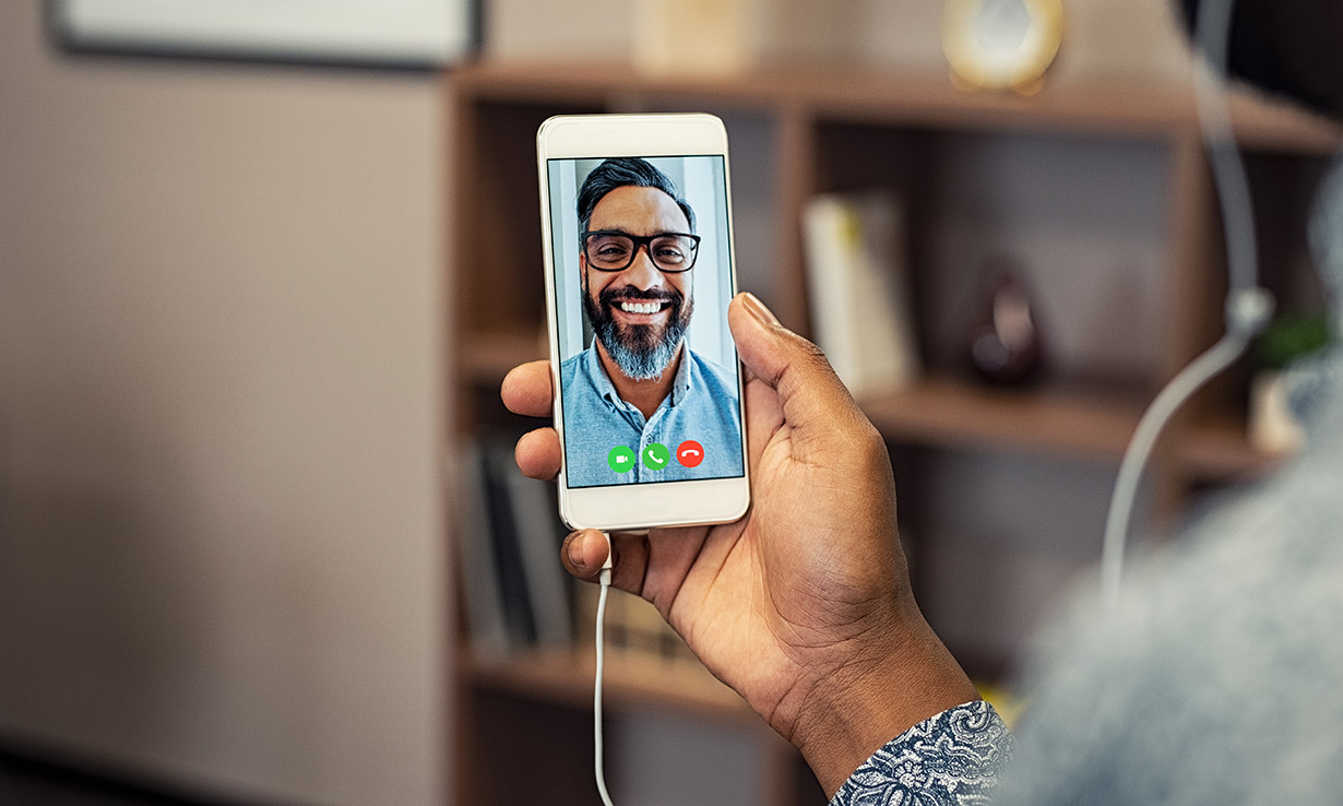 Someone making a video call on a mobile phone