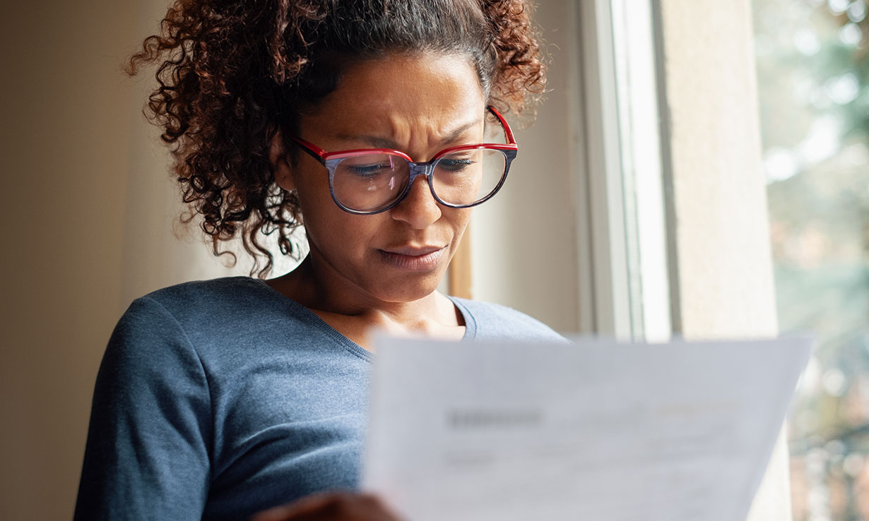 Woman looking at an energy bill