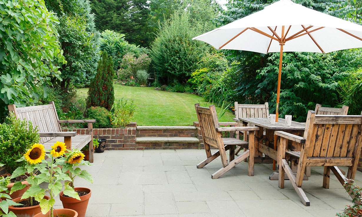 Garden with table and umbrella