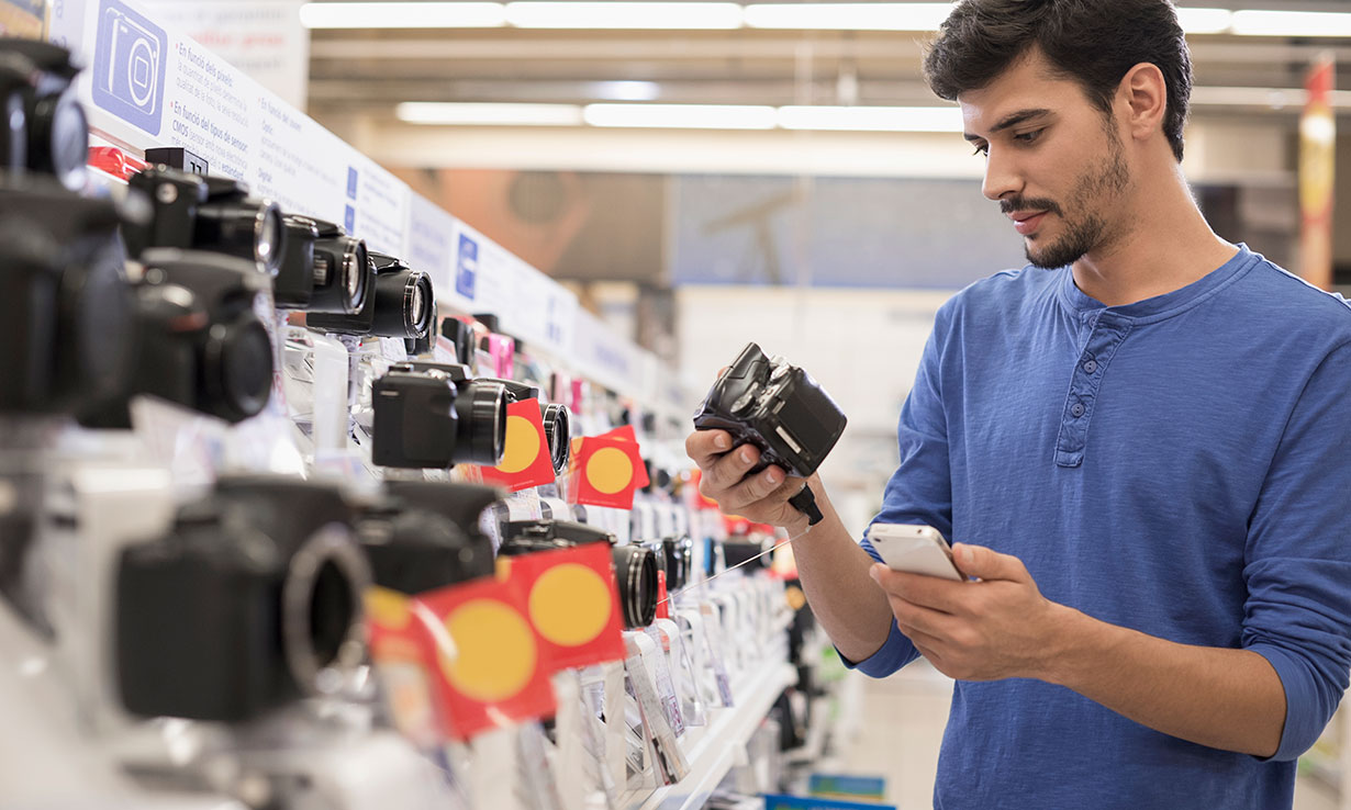 Man shopping for a camera