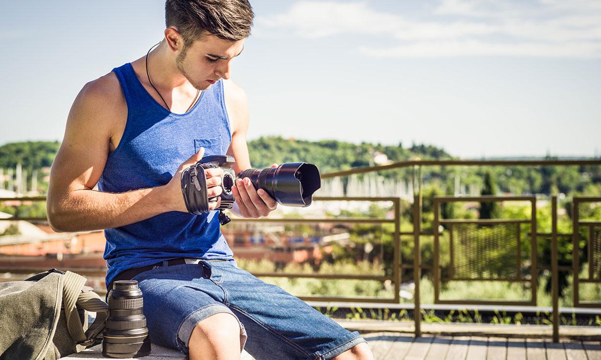 Man changing a camera lens