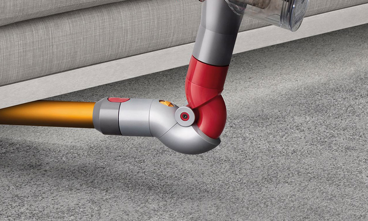 A closeup of Dyson's Reach Under tool in action