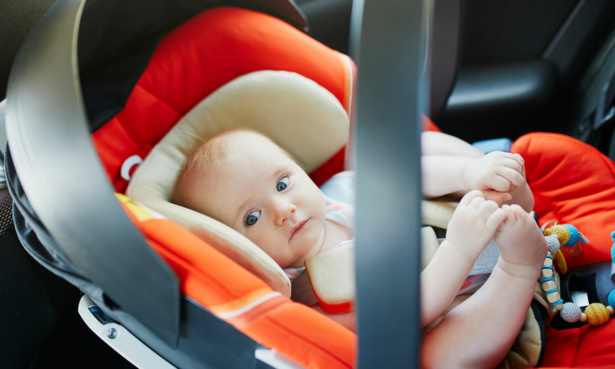 newborn baby in infant carrier car seat