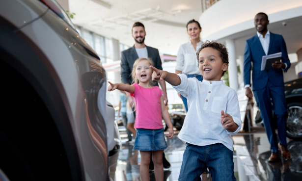 Family renting a hire car