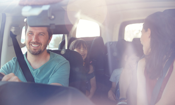 Family travelling in a car on holiday