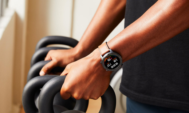 Amazfit GTR on wrist while lifting weights