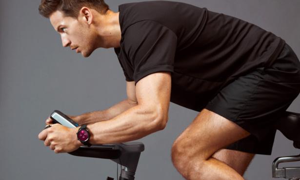 Man cycling wearing Mobvoi Ticwatch C2+