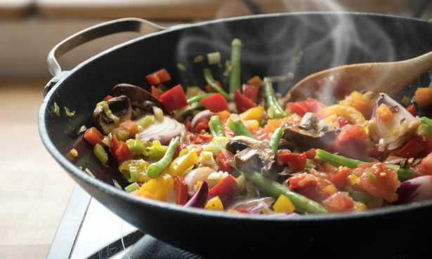 cooking vegetables in a wok