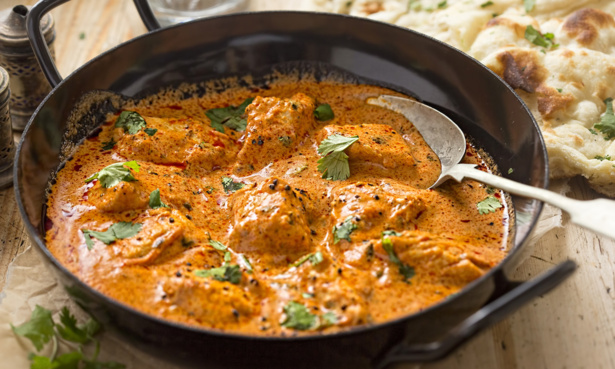 bowl of curry with coriander sprinkled over