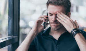 frustated man on the phone with energy company