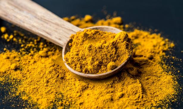 spoon of powdered turmeric