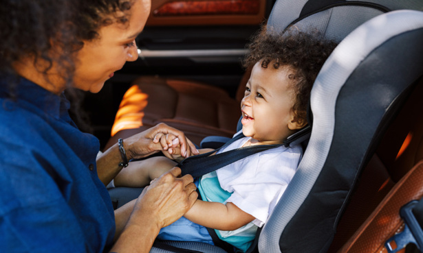 Mother and child in car seat