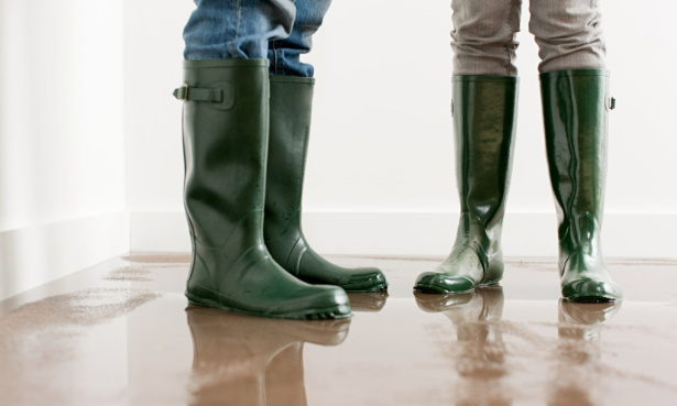 people in wellington boots during house flood