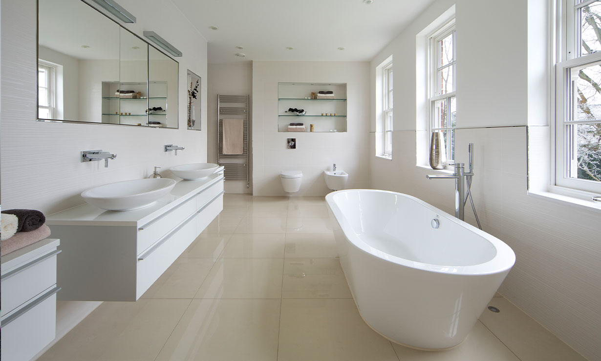 large bathroom with luxury, white fittings and mirrors