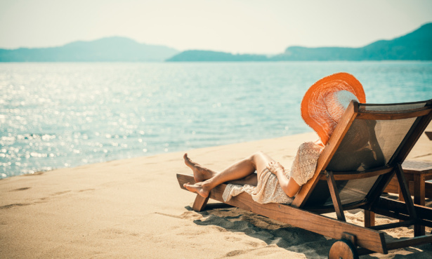 woman laying on beach holiday